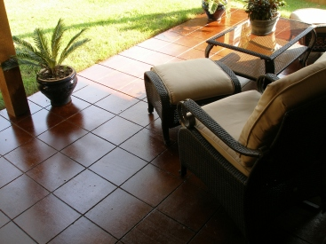 scored tiles/cola stained patio
