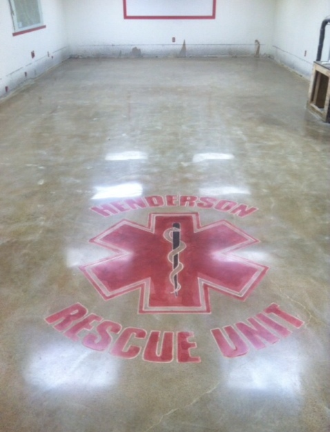 epoxy removed on existing floor and polished in a sand tone